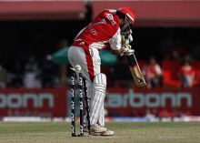 Punjab opener Paul Valthaty is clean bowled by Delhi paceman Irfan Pathan
