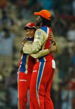 Bangalore openers Chris Gayle and Mayank Agarwal celebrate their team's win