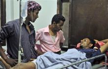 A man injued in the clashes in Yemen being treated