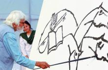 MF Husain with his painting