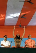 Yoga guru Baba Ramdev and his supporters attend yoga and bhajan session at Ramlila Ground in New Delhi