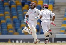 West Indies' Shivnarine Chanderpaul (left) and Ramnaresh Sarwan run between the wickets