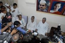 Chandrabhan, Outgoing RPCC chief C.P. Joshi and Rajasthan CM Ashok Gehlot address a press conference in Jaipur.