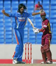India pacer Ishant Sharma and West Indies opener Lendl Simmons
