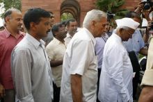 Civil society members Anna Hazare, Shanti Bhushan and Arvind Kejriwal arrive to attend Lokpal meet in Delhi.