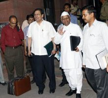 Lokpal panel members Santosh Hegde, Anna Hazare and Arvind Kejriwal after the Lokpal meet.