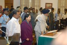Tamil Nadu Governor Surjit Singh Barnala, Chief Minister J. Jayalalithaa and A. Mohammed John during the swearing-in ceremony.