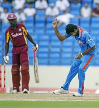 India pacer Munaf Patel celebrates the wicket of West Indies captain Darren Sammy