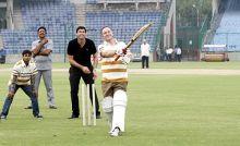 John Key playing cricket