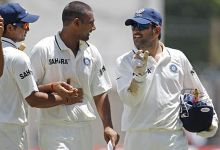 India captain Mahendra Singh Dhoni speaks with Praveen Kumar and Suresh Raina