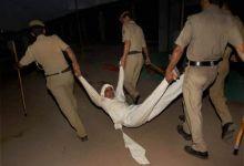 policemen evict Baba Ramdev supporter