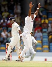 West Indies pacer Ravi Rampaul and India's Murali Vijay
