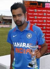India's Rohit Sharma poses with the Man of the Series trophy