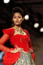 A model wears a Varun Bahl designed dress