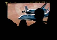 NASA exmployees watch video on space shuttle programme