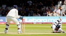 England's Ian Bell dives