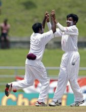 West Indies bowler Devendra Bishoo (right) with Adrian Barath