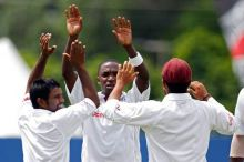 West Indies paceman Fidel Edwards (centre) and team-mates