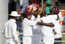 West Indies captain Darren Sammy (right) with bowler Fidel Edwards (second right) and team-mates