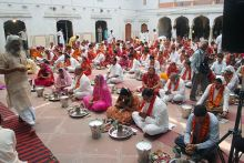 Devotees perform mass puja