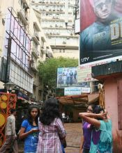 Mumbaikars watch movie at Roxy theater near Opera House in Mumbai