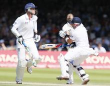 England's Matt Prior collides with India's Praveen Kumar