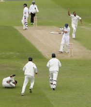 Praveen Kumar celebrates after scalping England captain Andrew Strauss