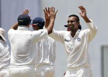 India paceman Praveen Kumar and team-mates