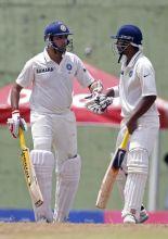 India's VVS Laxman (left) and teammate Abhinav Mukund