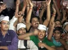 Supporters of Anna Hazare express their elation.
