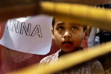 A young supporter of Anna Hazare stands at Ramlila Maidan in New Delhi