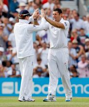 England's Tim Bresnan celebrates with Eoin Morgan