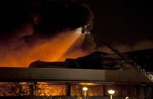 Firefighters fight a blaze at the Sony wharehouse