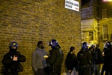 Youths are stopped and searched by British police officers