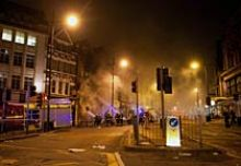 Firefighters tackle a blaze at a party store in Clapham Junction, south London