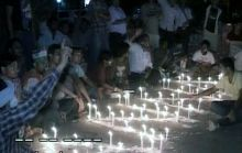 Supporters of Anna Hazare lit candels outside Tihar Jail in Delhi.