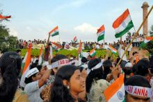 Anna Hazare supporters wave the Tricolour during a protest rally in Jaipur