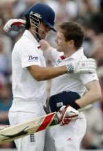 Eoin Morgan and team-mate Alastair Cook