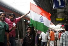Supporters of Anna Hazare protest at a railway station in Mumbai