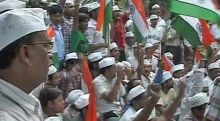 Supporters of Anna Hazare protest outside PM's house