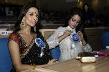 Bollywood actresses Malaika Arora Khan, left, & Raima Sen