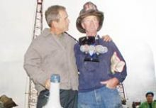 Former US President George W Bush with a rescue worker at World Trade Centre site