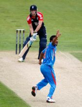 India's Praveen Kumar celebrates after taking the wicket of England's Craig Kieswetter