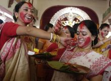 People celebrate during Durga Puja