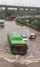 A DTC bus wades through waist-deep rain water in East Delhi