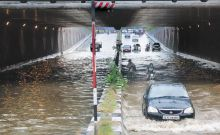 The left lane of Moolchand underpass was flooded with rain water