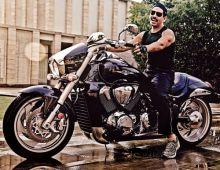 Robert Vadra rides a Suzuki Boulevard