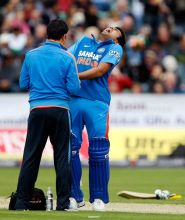 Rohit Sharma receives treatment for his injury