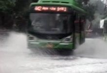 Bus ply on a water logged road in Delhi