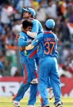 India celebrates the wicket of Ravi Bopara